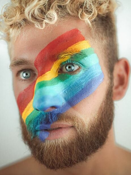 LGBT flag painted on a face