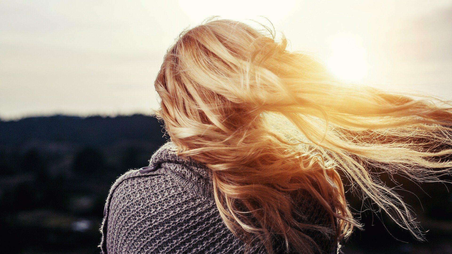 woman and sun rising